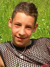 Gorgeous slim Boy gets undressed outdoor