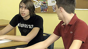 A teacher fucks his to twink students right there in class